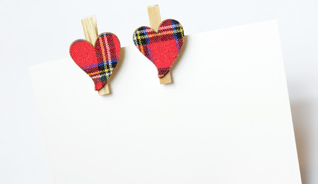 clasps: two hearts with red cloth, in plaid, with wooden clasps, next to each other, pinned to cards