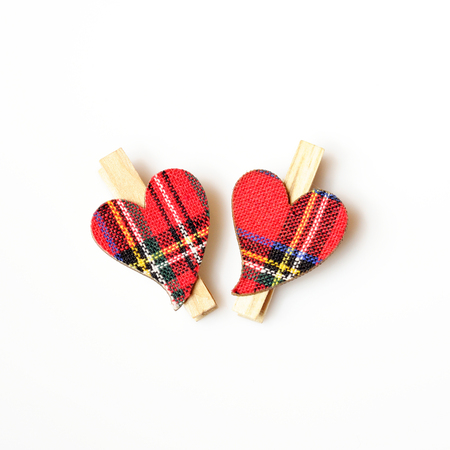 clasps: two hearts with red cloth, in plaid, with wooden clasps, next to each other on a white background Stock Photo
