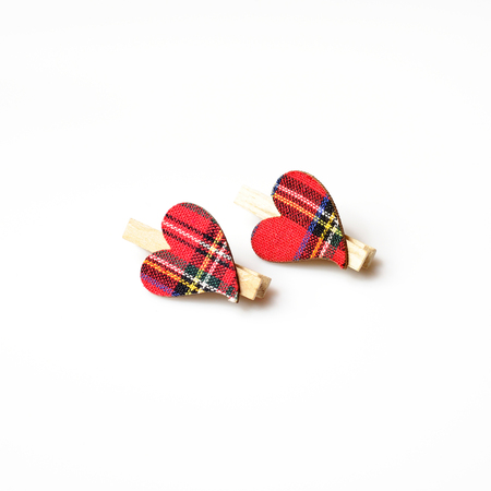 other: two hearts with red cloth, in plaid, with wooden clasps, next to each other on a white background Stock Photo
