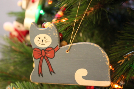 Cat Christmas ornament on tree Stock Photo