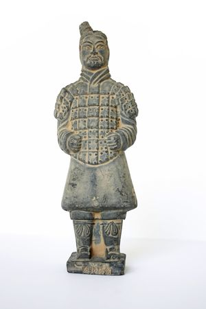 Front view of a standing terracotta worrier foot solider against a white background  Stock Photo