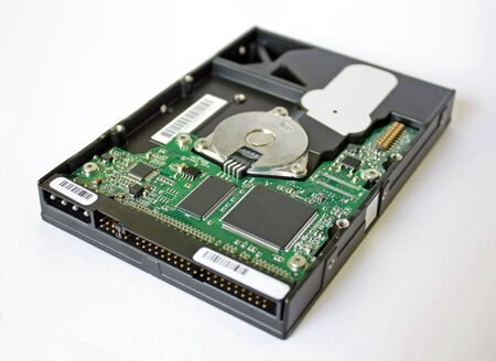 Perspective view of 3.5 hard disk exposing the curcuit board and microchips
