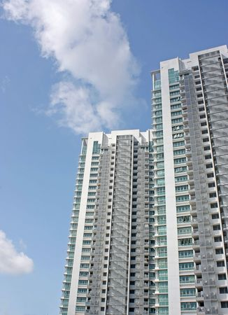 2 towers of a high rise condominium against a blue sky Editorial