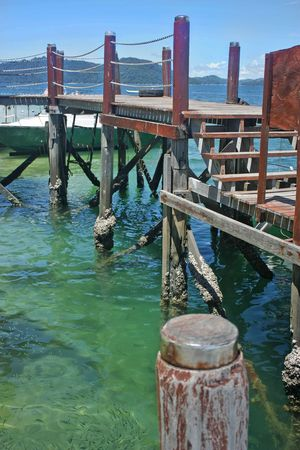 barnacles: Old jetty on an offshore tropical island of Sabah Malaysia. Stock Photo