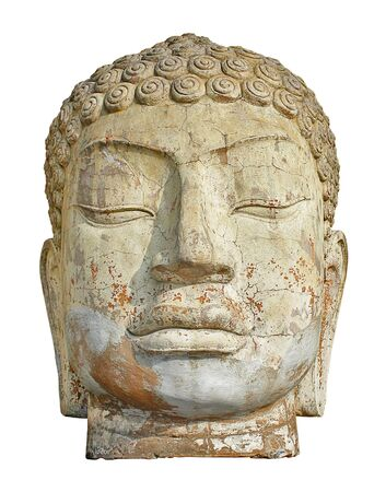 Front view of an ancient weather worn buddah head ruin