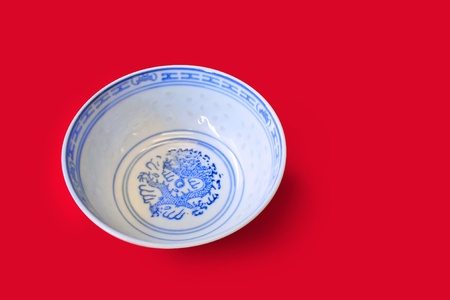 Traditional chinese porcelain bowl with oriental patterns and dragon motif