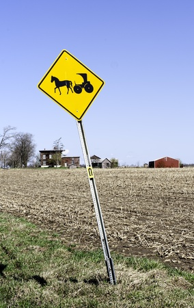 amish buggy: A higway sign in Nelliston, New York, warning of slow moving Amish horse and buggies  Stock Photo