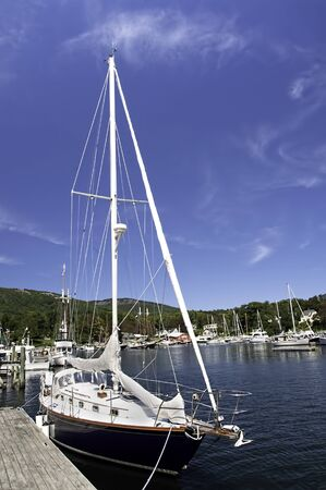 settles: A perfect blue sky settles over pristine Camden Harbor, Maine  Stock Photo