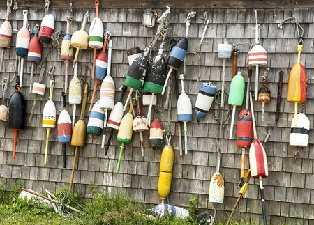 buoys: Lobster buoys and fishing shack on John Hancock Wharf - York Harbor, Maine Editorial