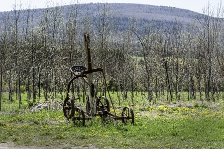 sulky: A vintage sulky plow rests in a field in Schoharie, New York