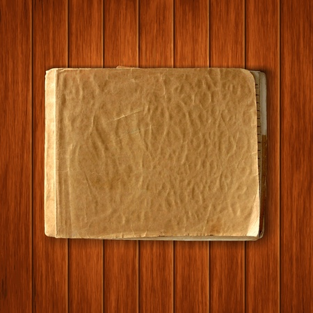 old blank notebook on wood texture background. scrapbook vintage template