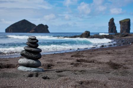 Zen tower on the beach of Mosteiros Stock Photo