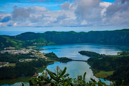 Sete Cidades on Sao Miguel is a small town in a volcanic crater with a big crater lake Stock Photo