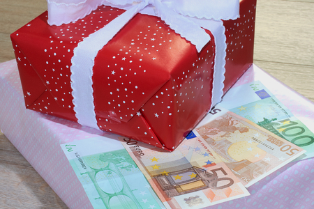 Christmas presents with Euro banknotes Stock Photo