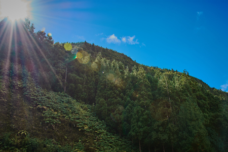 Sun shines over a crater mountain in the Azores