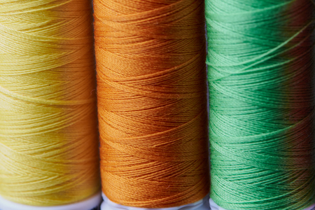 Close up of sewing thread colored