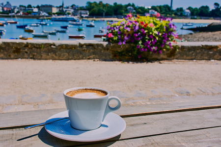 Cup of coffee at the port of Sainte-Marine in Brittany overlooking the port of Benodet