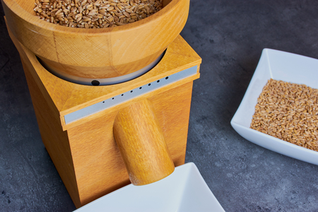 wooden domestic flour mill with spelt