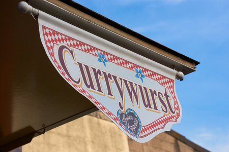 sign with the word Currywurst and Enjoy your meal in German Archivio Fotografico