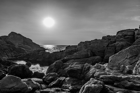 black and white picture of the granite rocks les rochers in Saint Guenole, France