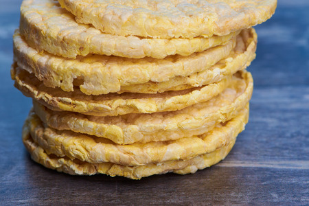 stack of corn wafers on a brown wooden surface Reklamní fotografie