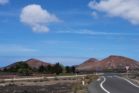 road near Yaiza in Lanzarote with view to the Timanfaya national park Stock fotó