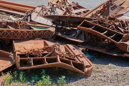scrap metal parts of boats lying around