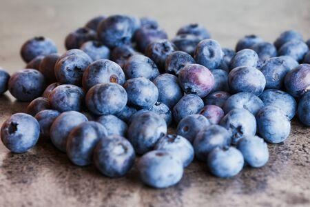 fresh raw blueberries on a gray kitchen desk