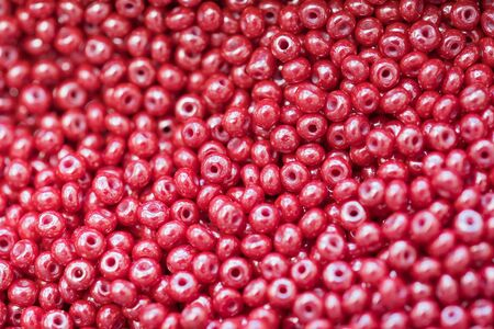 macro photo of red shiny plastic beads as background