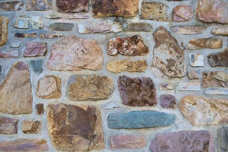 close up of stones in an old town wall as background