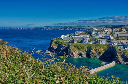 The pretty fishing village of Port Isaac has become a major tourist attraction after being featured in the ITV series Doc Martin where it is known as Port Wenn, HDR color photo
