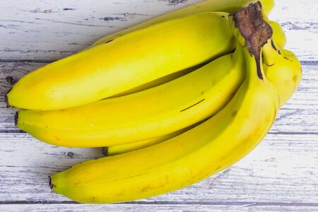bunch of bananas on a white wooden table Stockfoto