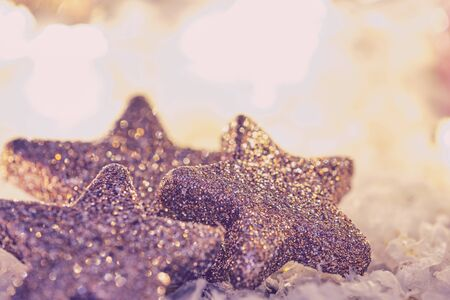 three glittery stars with bright shiny background with copy space, matt look