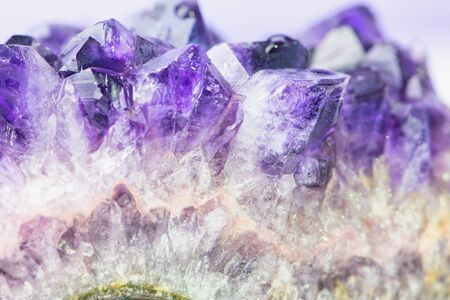 macro of violet amethyst gemstone, color photo