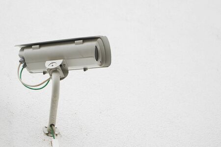 surveillance camera against a white wall with copy space Imagens