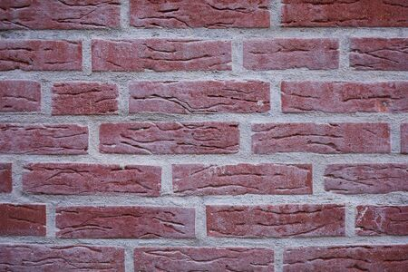 red brickstone wall as picture background, full format with copy space