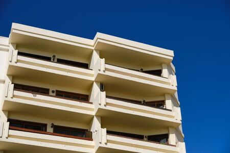 part of a yellow building in Spain with balconies Imagens