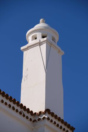 Spanish white chimney against blue sky on the Canary Islands Imagens