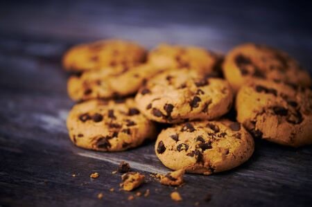 pile of chocolate cookies against wooden background