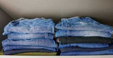 stack of female jeans in a cupboard