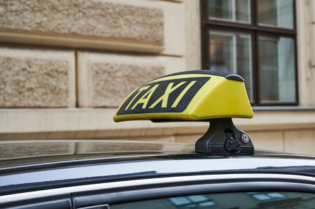 yellow taxi sign on a car in Vienna
