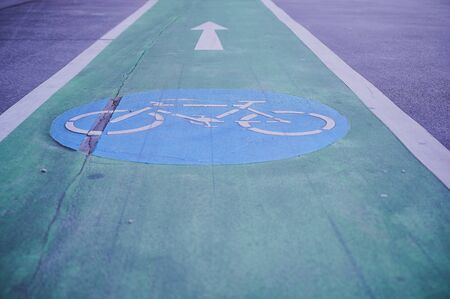 bike path with blue icon on a road in Vienna, Austria Stock Photo
