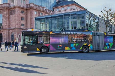 Mainz, Germany on March, 15 - 2020: bus line 60 drives in front of the theater in Mainz City. A bus of the MVG, the traffic operator for busses and tramcars in Mainz.