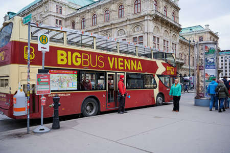 Vienna, Austria - February 19, 2020: Double deck tourist sightseeing bus operated by Big Bus Vienna stopped at a bus stop in the city center.