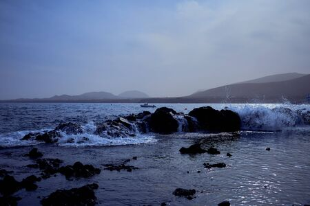 waves over volcanic rocks in front of Arrieta on Lanzarote, Canary Islands