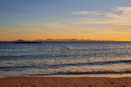 beach on Lanzarote during sunset with view to Fuerteventura, both belong to the Canary Islands, Spain