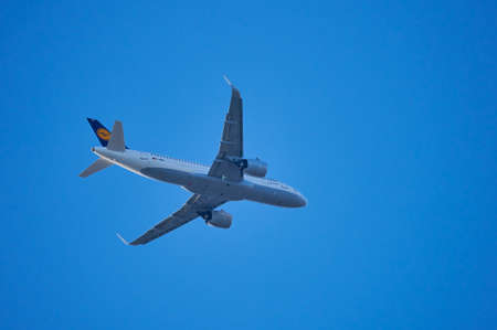 Mainz, Germany - April 10, 2020: Lufthansa Airbus A320 neo is flying over Mainz near Frankfurt airport, Germany.