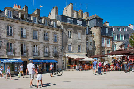 Vannes, France - July 11, 2019: People at the well known Place des Lices in Vannes which is the most important place in the center of Vannes, France Editorial
