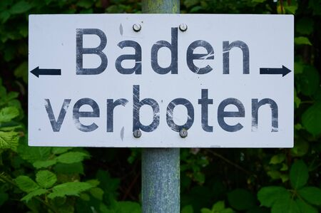 German sign with the words -bathing forbidden-
