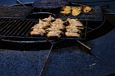 Chicken pieces are baked and roasted on a grill above the volcanic stone. It is in Timanfaya National Park, Lanzarote, Canary Islands, Spain.